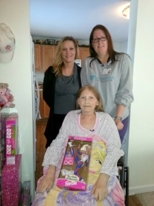 Brandi King and Lainee Killings pose with patient Beverly Parker
