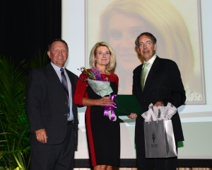 Debra Cook, center, receives statewide alumni award from Ivy Tech Kokomo Region Chancellor Steve Daily and Ivy Tech President Thomas Snyder