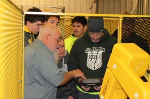 Kelsie Ollis, retired Chrysler robotics operator now teaching at Ivy Tech, describes controller for one of Ivy Tech's Fanuc Robots
