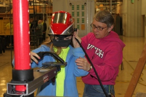 Nellie Neal, Ivy Tech welding instructor, guides one of the high school students through a demonstration of virtual welding