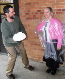 Jon Troyer  awards Patsy Favorite her prize as the people's choice for pie in the face