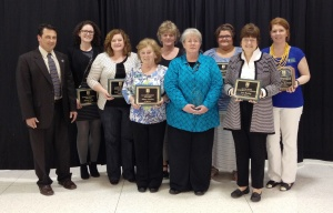 From left-right, Chancellor David Bathe with outstanding employee and board award winners Sarah King, Laura Lanning, Mary Pruitt, Laura Barnard, Kim King, Ashley Greer, Jan Bailey, and Shannon Niedzwicki