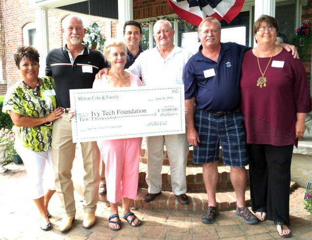 Jean Cole (center, holding check) was honored by family members Carmella and Keith Cole to her right and husband Milt Cole and Randy and Candy Cole, along with Ivy Tech Chancellor David Bathe, to her left.