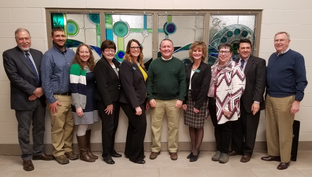 Kokomo Region Trustees John Adler (far left) and Tom McKaig (far right) pose with donors Johnathan and Dani McQuaide, Jan Bailey, Theresa Murphy, Steve Daily, Michelle Simmons, Fran Hardin, and David Bathe